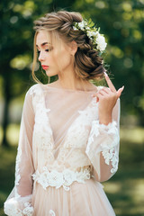 Bride in a beautiful dress. Professional make-up and beautiful hairstyle