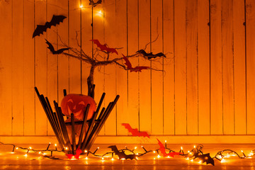 Halloween decorations on wooden background in home