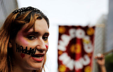 A supporter of presidential candidate Haddad of the Workers Party shouts slogans during a campaign rally in Sao Paulo