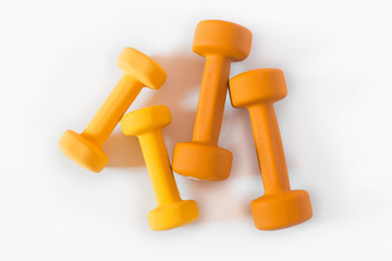 Yellow and orange dumbbells