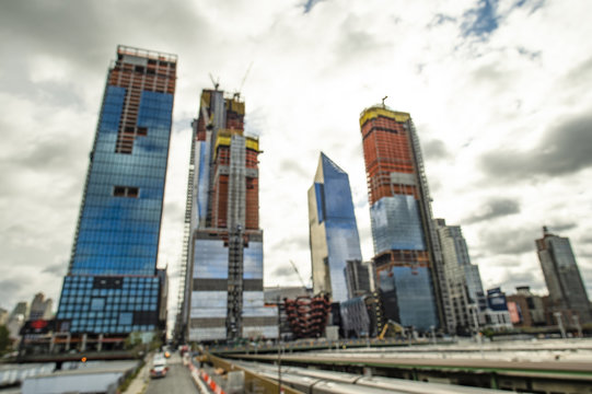 Blurred skyscrapers in construction. View from elevated High Line in Manhattan, New York, USA..