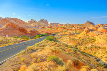 The scenic drive White Domes Road crosses Valley of Fire State Park to become the colorful Rainbow Vista Road. Valley of Fire is located in Mojave Desert, 58 miles of Las Vegas, Nevada, Unites States.