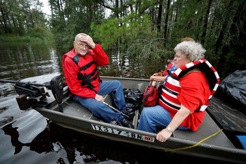 Lewis Combs, 85, and his wife Betty, 77, look out at the rising flood waters surrounding the church where they had been sheltering for three days from the effects of Hurricane Florence in Leland, North Carolina