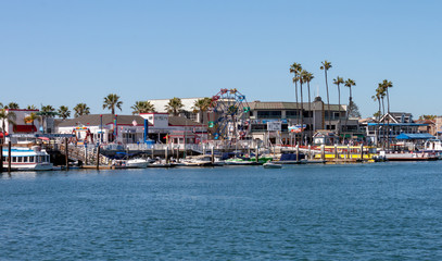 Balboa fun zone in Newport Beach California viewed from the bay on a sunny day