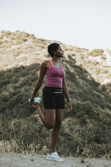 Woman stretching while on a hike