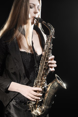 Keuken foto achterwand Muziek Saxophone player. Jazz musician saxophonist woman