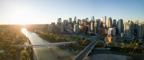 Aerial panoramic view of a beautiful modern cityscape during a vibrant sunny sunrise. Taken in Calgary Downtown, Alberta, Canada. Wall mural