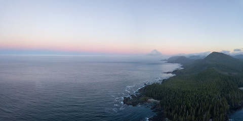 Fototapete - Beautiful aerial panoramic seascape view of Pacific Ocean Coast during a vibrant summer sunrise. Taken at Grant Bay, Northern Vancouver Island, BC, Canada.
