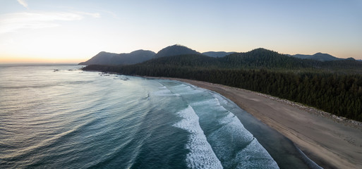 Wall Mural - Aerial panoramic view of a beautiful beach on Pacific Ocean Coast druing a vibrant sunny summer sunset. Taken in Raft Cove Provincial Park, Nortern Vancouver Island, BC, Canada.