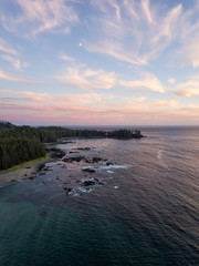 Aerial view of a beautiful beach on Pacific Ocean Coast druing a vibrant sunny summer sunset. Taken in Raft Cove Provincial Park, Nortern Vancouver Island, BC, Canada.