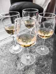 Close up of four champagne flute glasses with bubbling non alcoholic white grape juice ready for a toast making a festive New Year's Eve  celebration or anniversary occasion background.