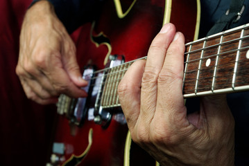 Guitarist hands and guitar close up