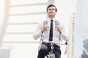 Businessmen riding bicycles