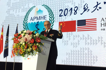 Rear Admiral Louis C. Tripoli, Command Surgeon of the United States Indo-Pacific Command, gestures during his speech at the Asia Pacific Military Health Exchange 2018, in Xian, Shaanxi