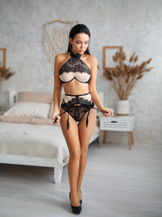 sexy woman with dark hair in black lingerie