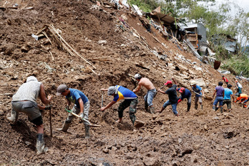 Rescuers search for people trapped in a landslide in Itogon following super typhoon Mangkhut