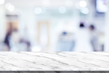 Empty white marble table top with blur patient waiting for doctor at hospital with bokeh light at background,Mock up template for display of your design,Banner for advertise of product,panorama view