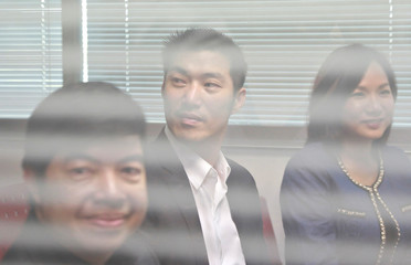 Thanathorn Juangroongruangkit, founder of Thailand's Future Forward Party sits at Technology Crime Suppression Division in Bangkok