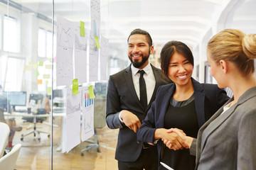 Businesswoman contratulates collegue success