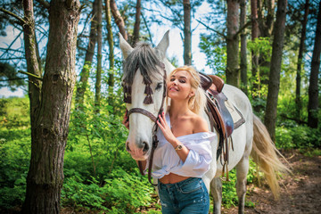 Woman hugging her horse - Concept about love between people and animals . Beautiful lady lifestyle with best friend horse in countryside. Portrait of human and animals for pet life concept outdoor