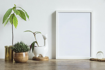 Interior of home space with mock up photo frame, avocado plant and white lama sculpture pot. Vintage concept..