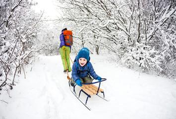 Kid on the sleigh.