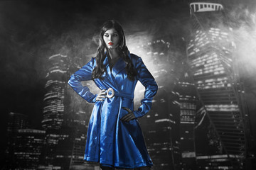 woman in a blue coat with red lips black and white in the city of sins