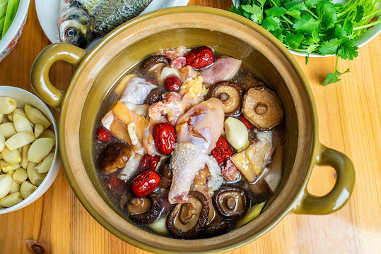 Fresh chicken and red dates mushrooms in the sand