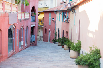 Colorful street in the town of Villefrance, French Riviera