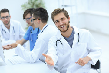 friendly doctor making a welcome gesture