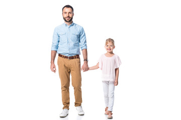 father and daughter holding hands and looking at camera isolated on white