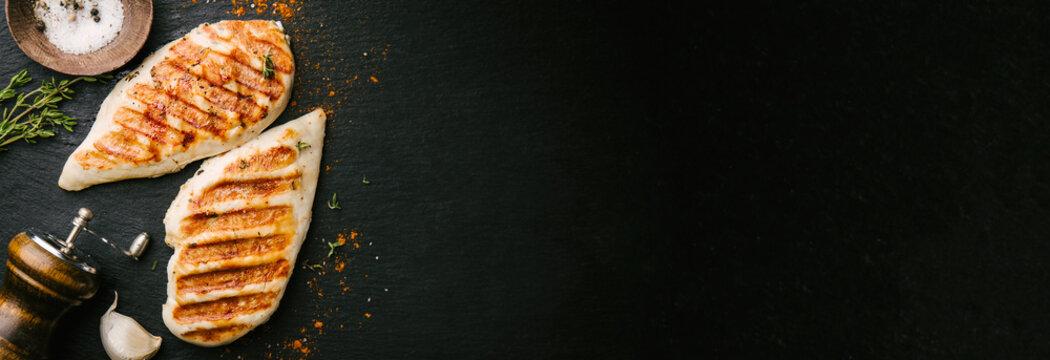 Grilled chicken breast served on black slate