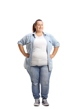Overweight woman standing with hands on her waist