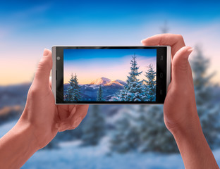 Carpathian mountain at winter covered with snow on a screen of smartphone