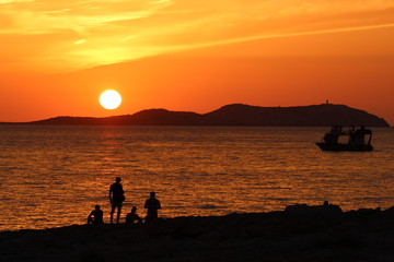 ibiza sunset with group of friends silhouette
