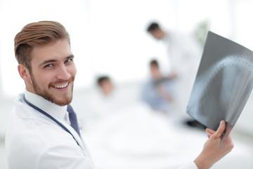 closeup.surgeon examining an x-ray.
