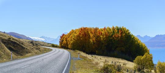 Panoramic scenery of Mount Cook /Aoraki road along Lake Pukaki , Mackenzie District in autumn , Canterbury region, South Island of New Zealand