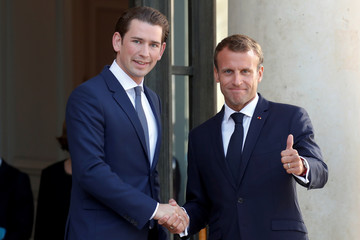French President Emmanuel Macron greets Austrian Chancellor Sebastian Kurz as he arrives for a meeting at the Elysee Palace in Paris