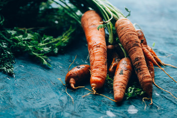 Fresh carrots on a blue wooden background