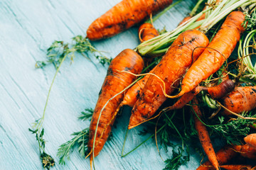 lot of carrots on a wooden background