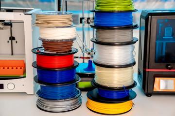Fototapeta ABS and PLA filament next to 3D Printer. Plastic   coils obraz