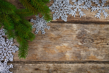 Silvery snowflakes and fir branches