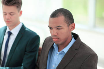 young businessman on the background of the employee