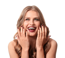Fashionable young woman with beautiful manicure on white background