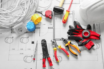 Different electrician's supplies on electrical scheme Wall mural