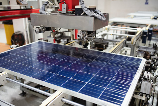 Manufacturing of solar panel system in factory.Industry concept