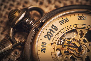 New year concept for 2019 with brown pocket watch