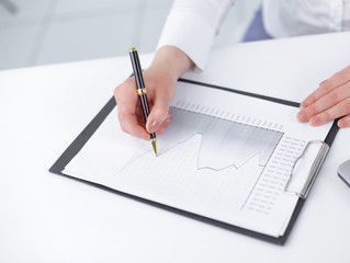business woman analyzing the financial schedule
