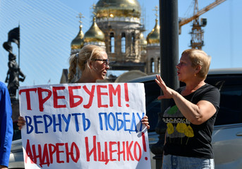 Supporters of candidate Ischenko protest in a street following the election for governor of Russia's Primorsky Region in Vladivostok