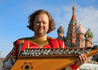 Musician with old Russian music instrument gusli